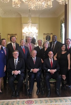 Gov. Greg Abbott, Lt. Gov. Dan Patrick, and House Speaker Dennis Bonnen stop for a photo op at the governor's mansion.