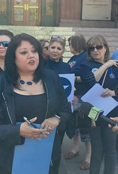 Bexar County Democratic Party Chairwoman Monica Alcantara speaks to the press outside the Bexar County Courthouse.