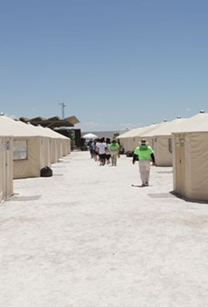 Staff and detainees walk between the tents inside the Tornillo, Texas, detention center for immigrant children, which closed earlier this year.