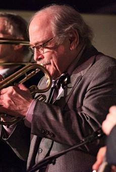 Jim Cullum playing trumpet during a gig