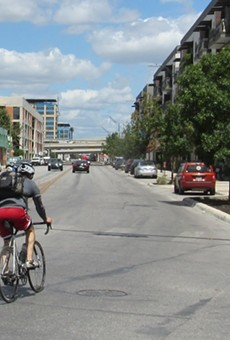 A cyclist pedals north from downtown on Broadway.