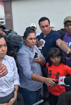 Julián Castro speaks with asylum seekers waiting in a camp across from Brownsville.