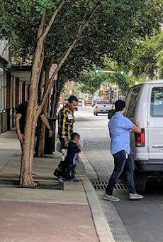 Asylum seekers leave the city's Migrant Assistance Center.