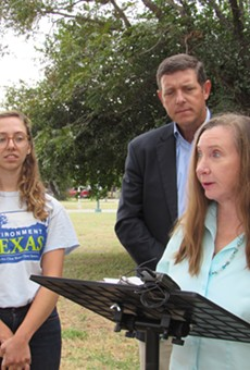 Annalisa Peace of the Greater Edwards Aquifer Alliance speaks as Anna Farrell-Sherman (left) of Environment Texas and Joseph Fitzsimons, founder of the Texas Coalition for State Parks, look on.