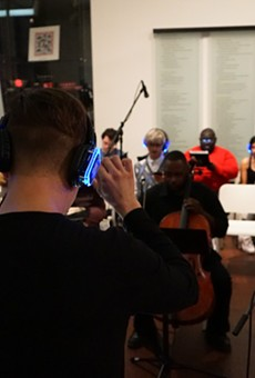 Richard Castillo conducts musicians during a rehearsal of Nathan Felix's headphone operettas.