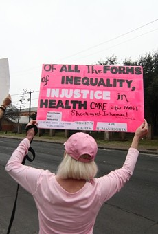 Protesters hold signs at a pro-Planned Parenthood rally in San Antonio.