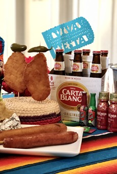 The NIGHT IN OLD SQZBOX party packs include Fiesta favorites such as chicken on a stick, gorditas, footlong sausages and footlong corndogs.