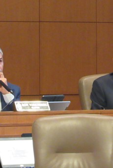 Mayor Ron Nirenberg (left) and Councilman Clayton Perry listen to a speaker at city council meeting.
