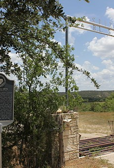 A historical marker stands along the road in Kimble County.