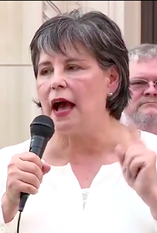 Cynthia Brehm speaks at a recent rally at which she claimed the coronavirus pandemic is a Democratic hoax.