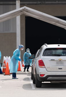 Cars pull up to the city's mobile coronavirus testing site at Freeman Coliseum.