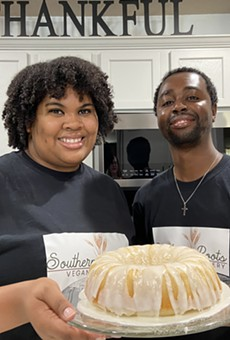 Marcus and Cara Pitts of Southern Roots Vegan Bakery show off one of their cakes.