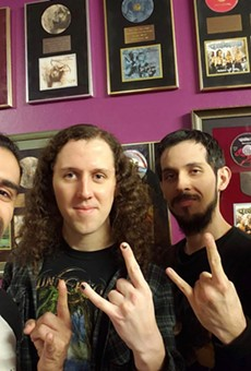 The San Antonio metal band poses with  renowned Finnish producer Anssi Kippo (right) while recording its latest album.