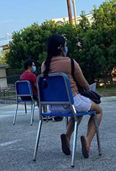 Texas State University Student Tweets Viral Photo of Parking Lot Coronavirus College Class
