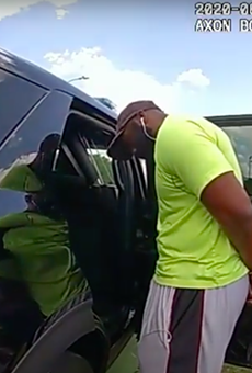 Body cam footage shows officers detaining jogger Mathias Ometu last week.