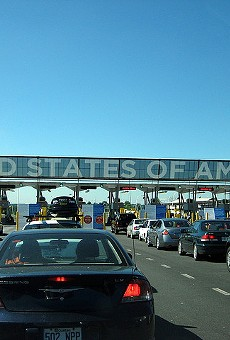Cars line up to pass in to the U.S.