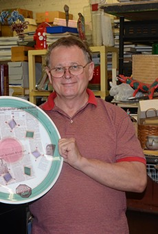 Gene Elder with one of his LGBT history plates.
