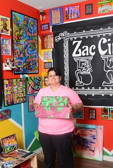 Nina Donley surrounded by her artwork at her West Side gallery, Zac Cimi Arte.