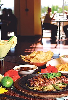 Go for the drinks, but load up on post-happy hour food.