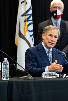 Gov. Greg Abbott (center) speaks during a recent press conference.
