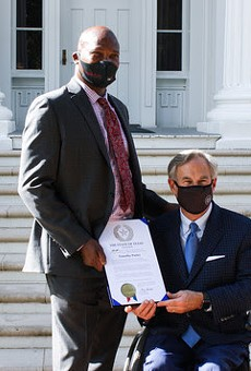 Timothy Porter of San Antonio (left) receives a recognition from Gov. Greg Abbott.