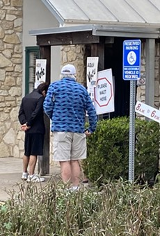 Voters wait in line to vote at Lion's Field in San Antonio.
