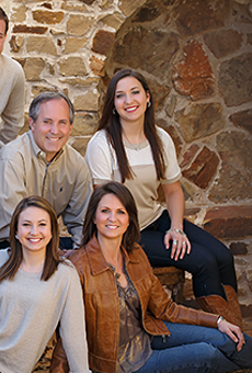 Ken Paxton and his family pose in a campaign photo. Paxton's wife Angela is on the bottom right.