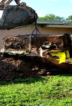 A coffin was found buried in a backyard on Elm St.