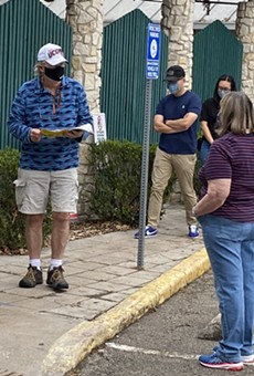 Voters line up outside of the Lion's Field polling site in San Antonio.