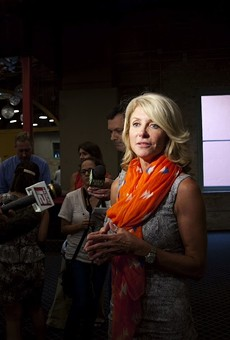 Wendy Davis speaks with reporters at a #StandWithTXWomen rally.