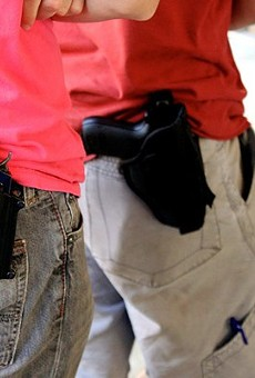 Licensed gun owners will be able to legally carry holstered firearms on January 1.
