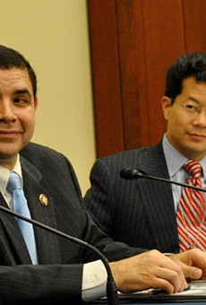 Rep. Henry Cuellar (left) announced more funding for immigration judges and support staff.
