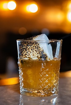 The Campfire Marshmallow Old Fashioned is topped with a flame-toasted marshmallow.