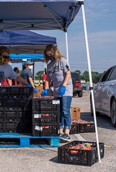 Volunteers unload pallets at a recent San Antonio Food Bank distribution.
