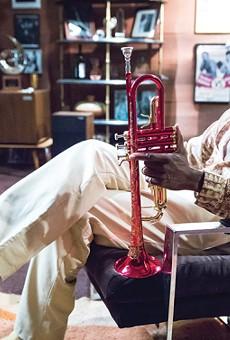 Don Cheadle as Miles Davis