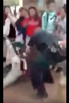 Screenshot of the video showing an SAISD video slam a girl to the ground.