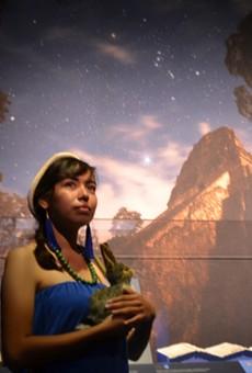 An actor impersonates Ixchel, the Maya goddess of motherhood, fertility and the moon.
