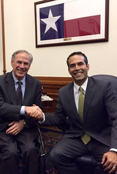 Texas Governor Greg Abbott and Texas General Land Office Commissioner George P. Bush shake hands in this November, 2015 Facebook photo.