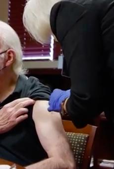 Spurs Coach Gregg Popovich receives a COVID-19 vaccine in a new public service announcement.