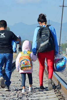 A 16-year-old girl and her two younger siblings are seen in this December 10, 2014, near a catholic charity that serves migrants at a nearby train station. The trio was in Mexico. They were trying to reach the U.S. from Honduras.