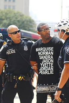 Black Lives Matter organizer Mike Lowe is shown being arrested last summer in the file photo. Mayor Ivy Taylor has invited him to join a task force on police accountability reform. Lowe criticized a collective-bargaining agreement passed by City Council Thursday for not including accountability reform.