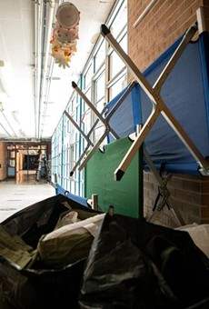 Cots and bags with items at Reilly Elementary School in North Austin. The school was turned into a warming shelter during the recent winter storm.