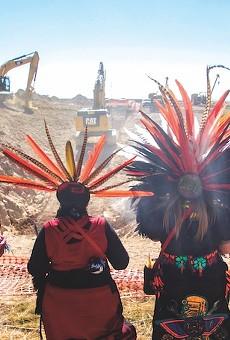 Members of San Antonio-based Kalpulli Ameyaltonal pray at the site of the Trans-Pecos Pipeline construction close to Marfa, Texas.
