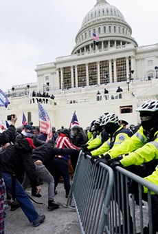 Insurrectionists tangle with police during the January 6 insurrection at the U.S. Capitol.