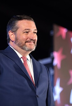 U.S. Sen. Ted Cruz smirks from the stage at a 2019 event hosted by conservative group Turning Point USA.