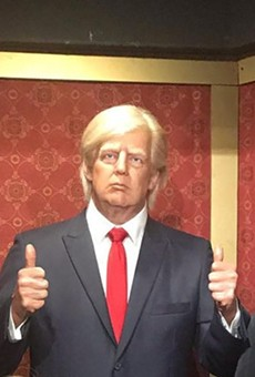 The wax dummy of former President Donald Trump, shown in a visitor's photo, was packed off to storage after people kept punching it. No word on whether his two BFFs also suffered damage.
