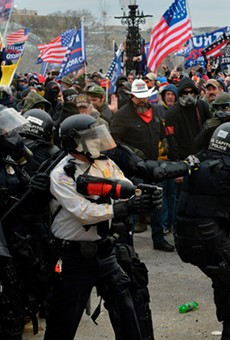 Police battle with supporters of Donald Trump as they breach barriers around the U.S. Capitol on January 6.
