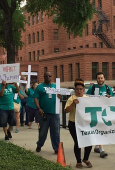 Texas Organizing Project members march in front of the Bexar County Courthouse during 2019 protest for bail reform.