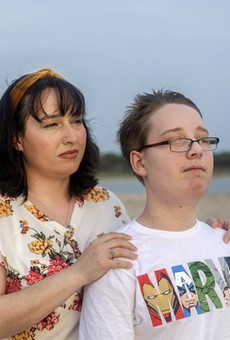 Trish and her 12-year-old son look out into the sunset at Canyon Lake on April 13, 2021. Trish earns too much to qualify for Medicaid in Texas but too little to afford her own health insurance. Her son does qualify for Medicaid.