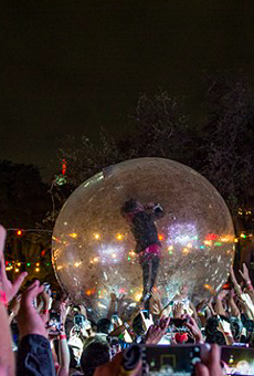 The Flaming Lips' Wayne Coyne belts it out from inside a plastic bubble during the band's 2016 performance at the Maverick Music Festival.